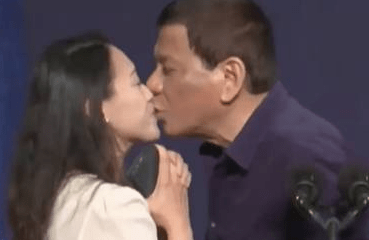 Philippines president Rodrigo Duterte sparks outrage for kissing woman on stage