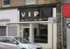 Couple caught romping in barbers shop in broad daylight as stunned passersby watched (Video)