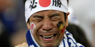 Heartbroken Japan fans clean stadium in tears after last-gasp loss to Belgium,.