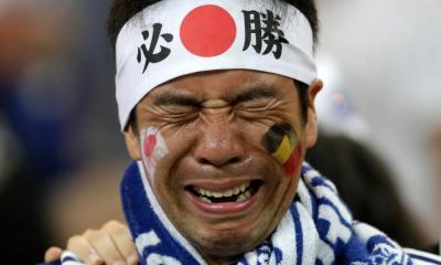 Heartbroken Japan fans clean stadium in tears after last-gasp loss to Belgium,.