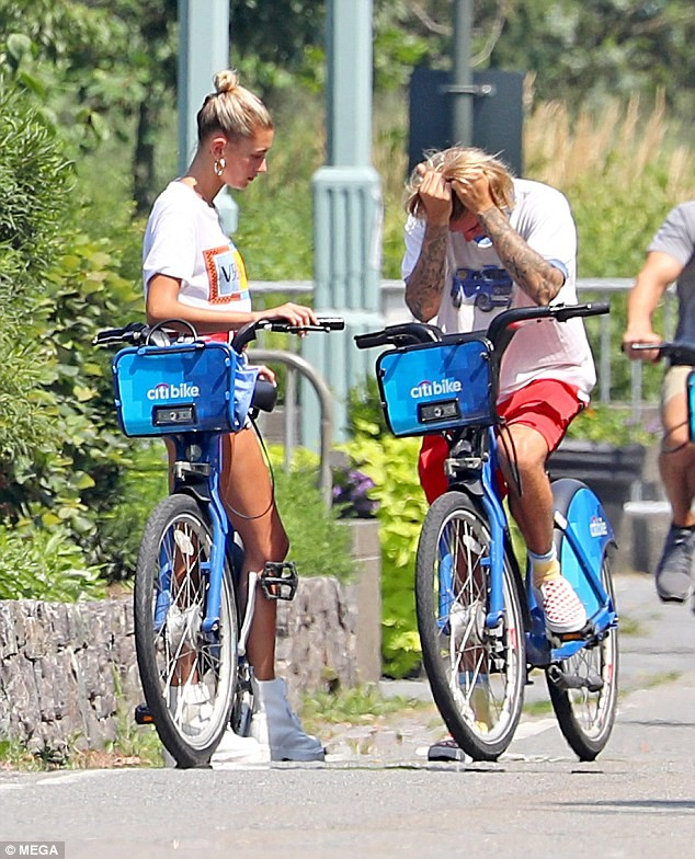 Justin Bieber's fiancee Hailey Baldwin comforts him as he breaks down in tears during emotional outing in New York