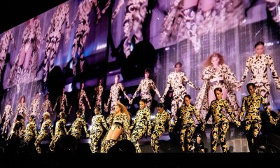 Beyonce flaunts her hot legs as she performs with background dancers in matching Versace ensembles (Photos)