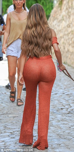 Demi Rose goes underwear-free as she slips her curves into racy sheer crochet co-ords