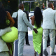 Kanye West carries Kim Kardashian out of their G Wagon and grabs her butts as they arrive at 2 Chainz's wedding in Miami