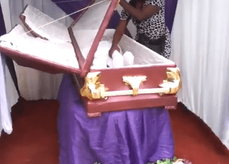Anambra man attempts to bury carved wood in place of his brother (photos/video)