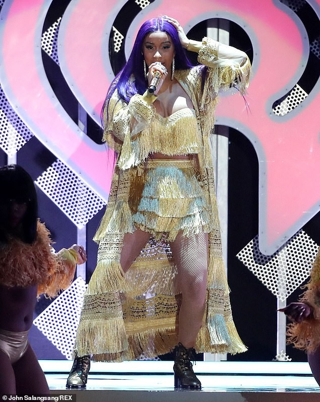 Cardi B puts on a very busty display as she flaunts her backside on stage