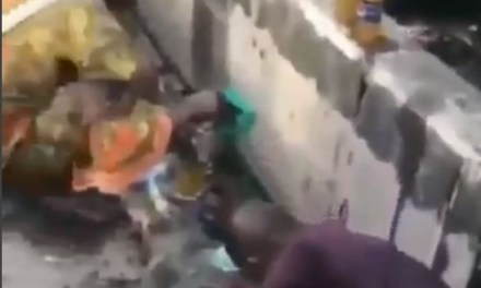 Embarrassing video of Lagosians scooping vegetable oil that spilled into a gutter
