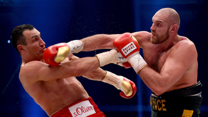 Britain's heavyweight boxing fighter Tyson Fury endured two brutal knockdowns by WBC heavyweight champion Deontay Wilder