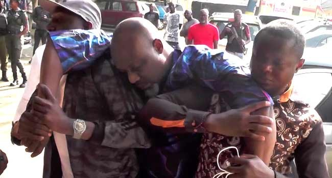 Dino Melaye slumps as he arrives Police headquarters
