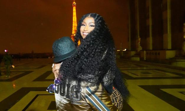Nicki Minaj shares loved-up photos with her man as they pose together in front of the Eiffel Tower