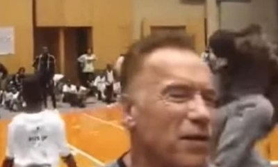 Arnold Schwarzenegger is dropped kicked in the back while attending an event in South Africa