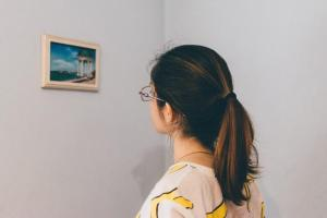 Woman looking at painting