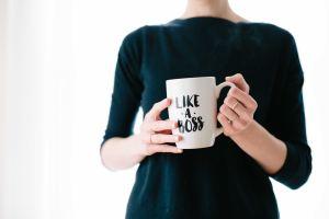 "Lady holding a ""like a boss"" mug"