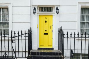 renovating your home on a budget - New yellow front door