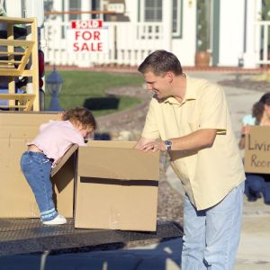 a man and his child with moving boxes