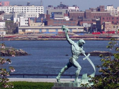 UN Statue man beating sword into plowshare from isiaiah, the bible