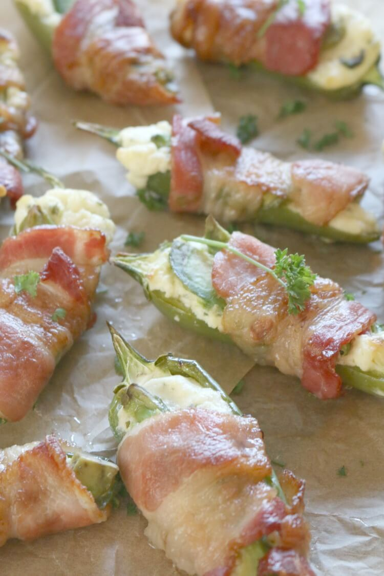Bacon Avocado Jalapeño Poppers -With only 5 simple ingredients, these Jalapeño Poppers are filled with creamy cheese mixture topped with an avocado slice and wrapped with crispy bacon as it's baked to perfection.