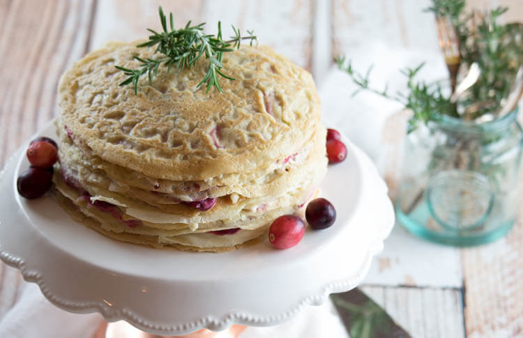 Paleo Crêpe Cake with Cranberries -This Paleo Crêpe Cake with Cranberries is gluten-free, dairy free and nut-free. Perfectly satisfying with graceful layers of crêpes, whipped coconut cream and maple-sweetened cranberries. #paleo #crepes #dairyfree