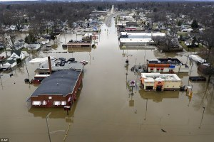 Floodwaters kill at least three in Midwest and South as hundreds flee their homes and Coast Guard rushes to save stranded families