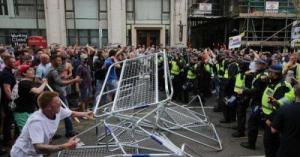 Watch As Chaos Erupts At Tommy Robinson Protest; Police Chased Down Street As 1000s Rage