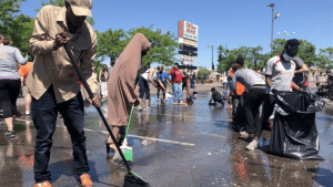 Neighbors From All Walks of Life Hit Minneapolis Streets to Help Clean Up After Days of Unrest