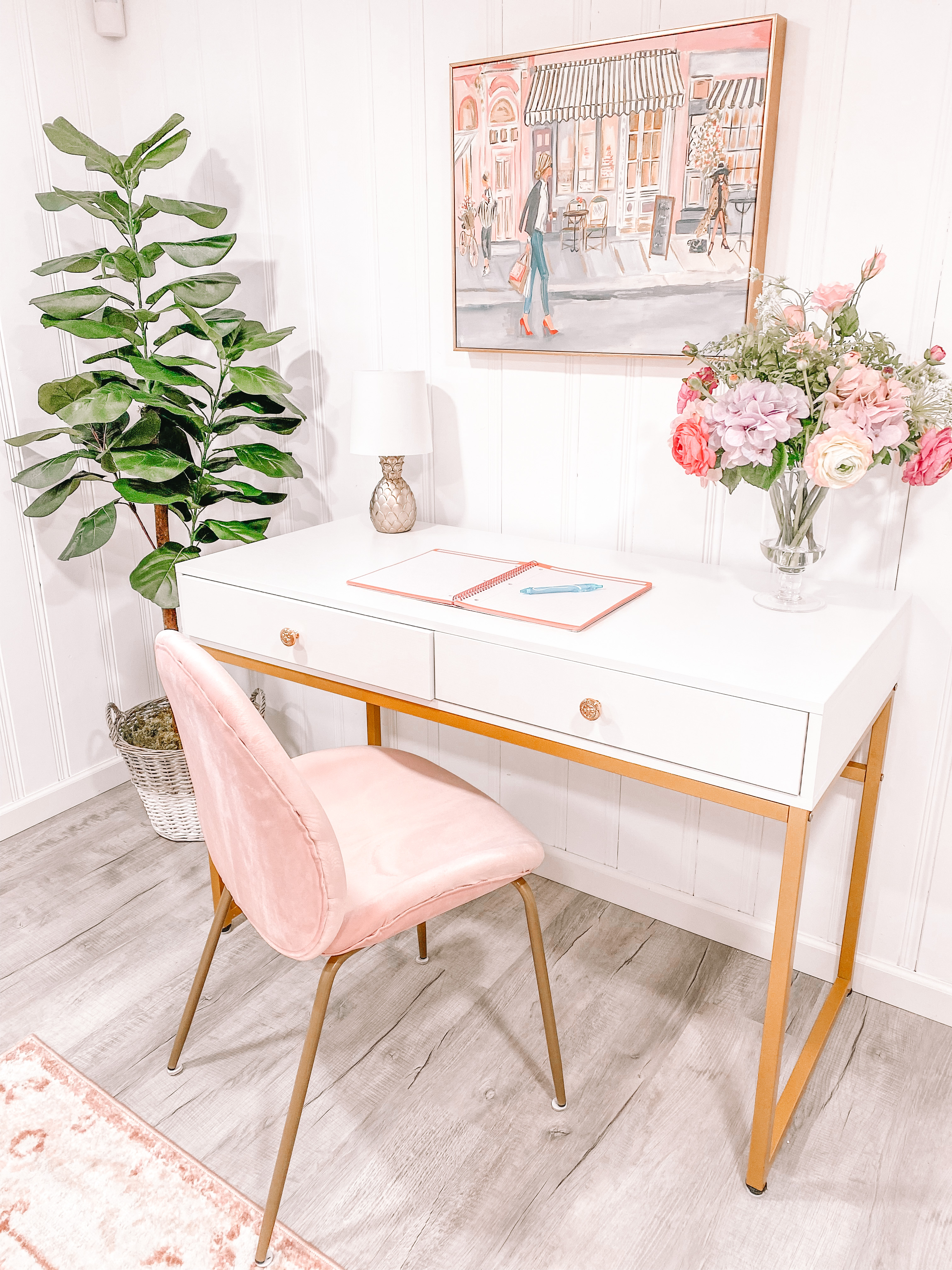 white home office desk and blush pink chair