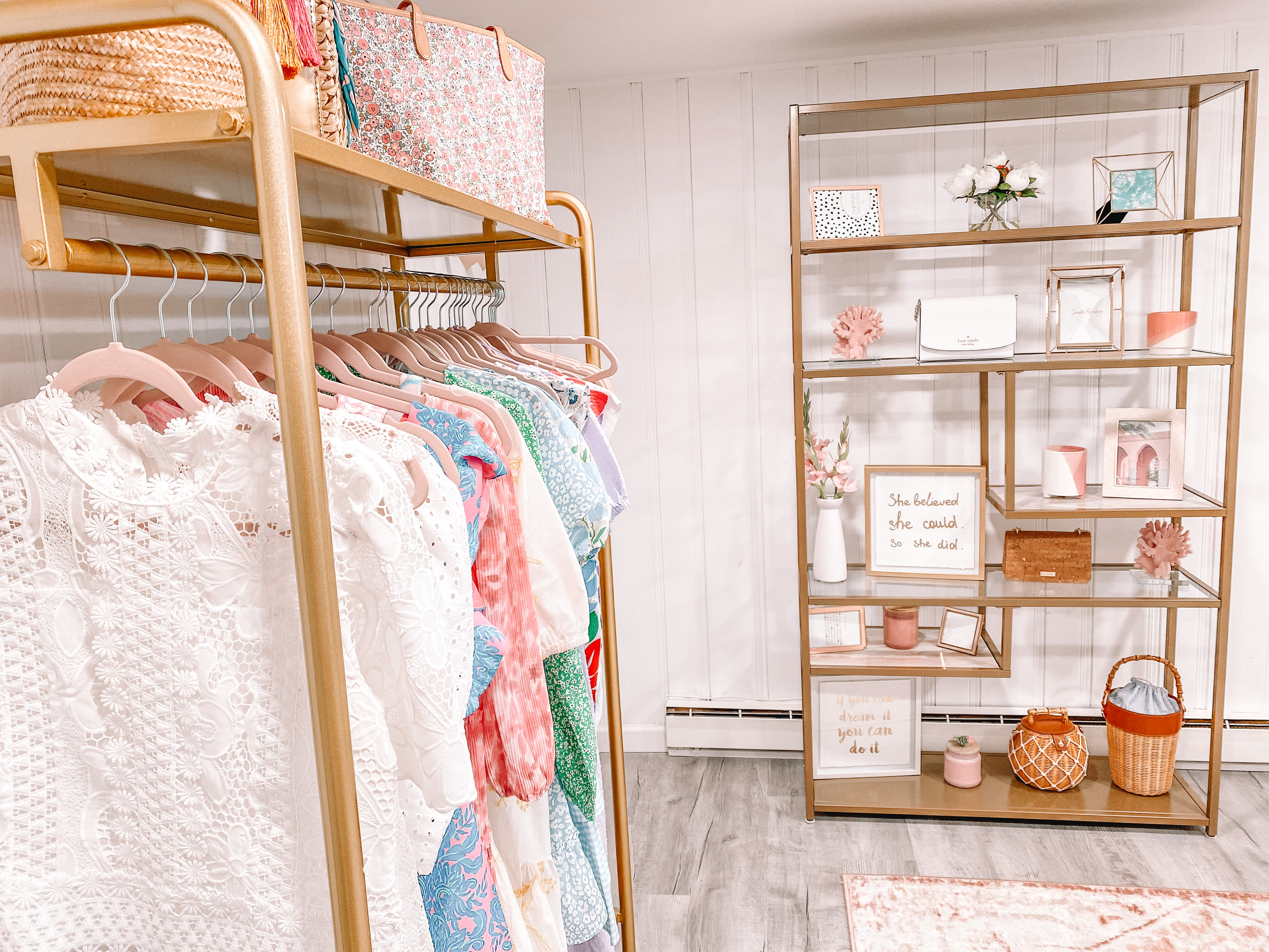 clothing in home closet and office with gold shelves in background