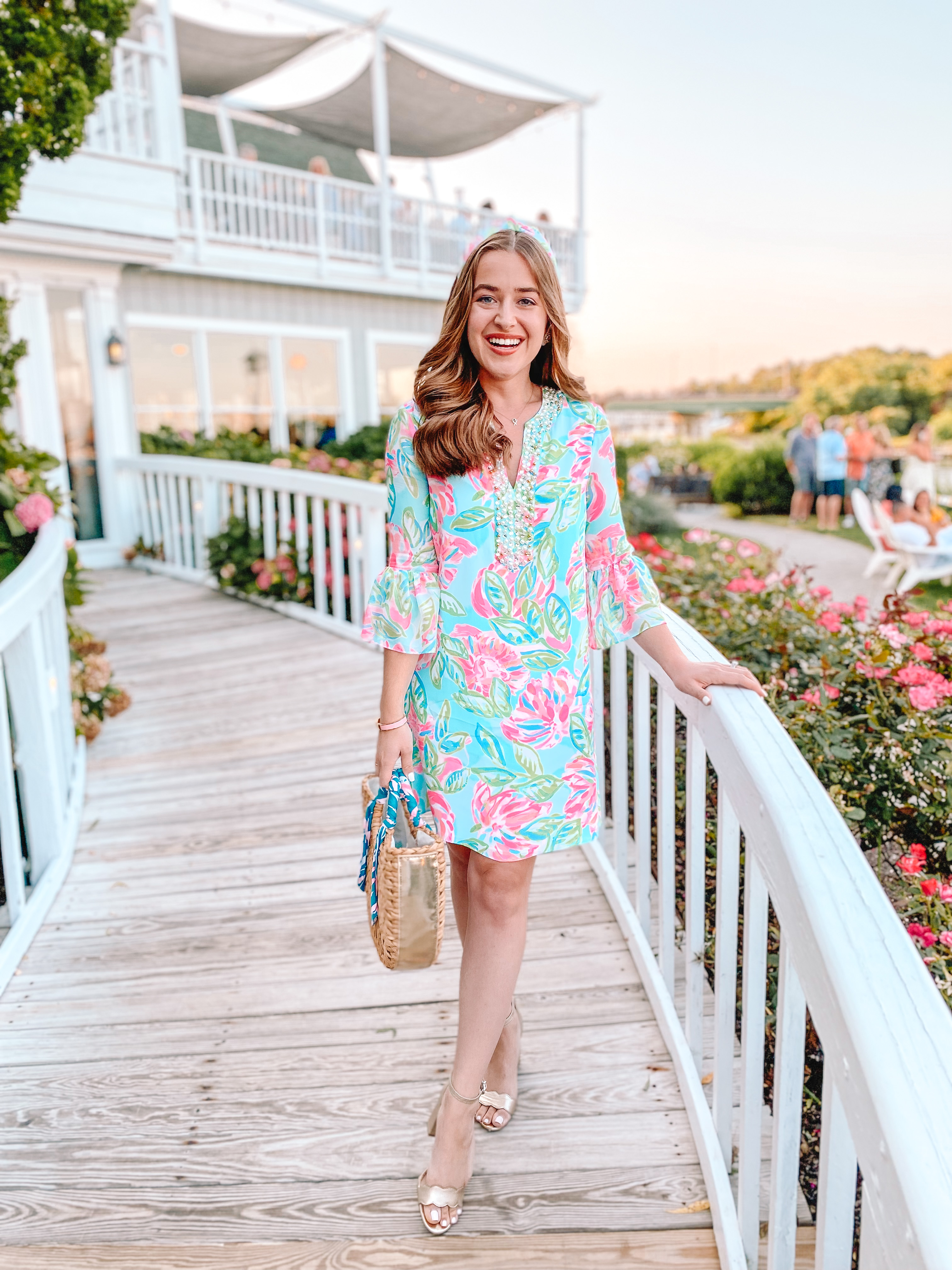 woman smiles at sunset wearing lilly pulitzer thinking about the sunshine sale