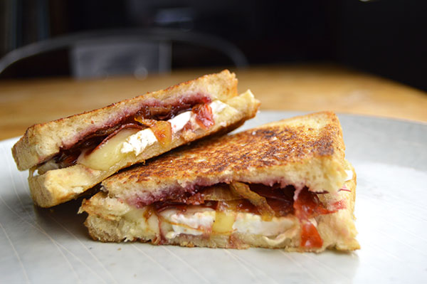 gourmet grilled cheese with jam and caramelized onions