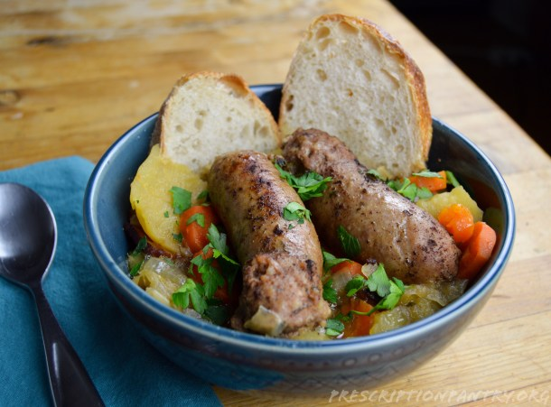 Dublin coddle in bowl with bread