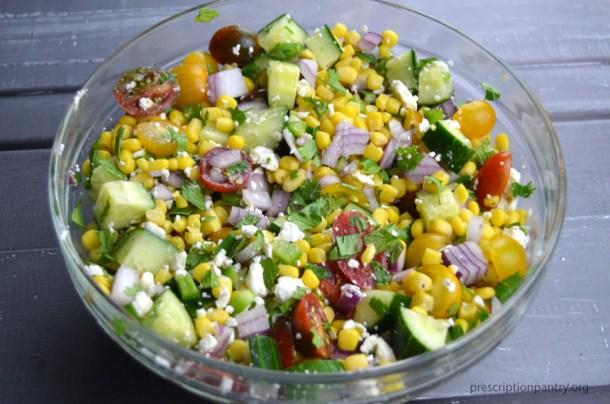 corn salad tomato cucumber herbs feta