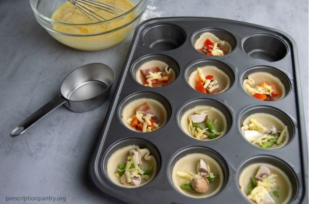 vegetables in mini quiche crust muffin pan tin