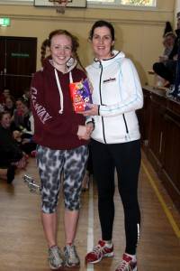 Chloe Crowe being presented her prize from Ms Cosgrove for the best hairstyle, well done Chloe