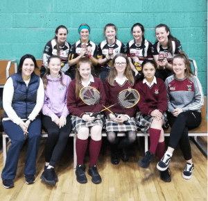 U16 Badminton Team along with coach Ms. McGuire, 2nd year referees and activity leader Laura O'Dea.