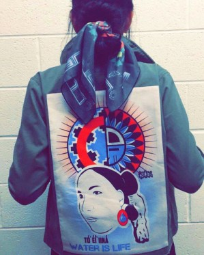 OXDX jacket and scarf tied in a tsiyeel (Navajo hair bun)! Photo credit: Jared Yazzie