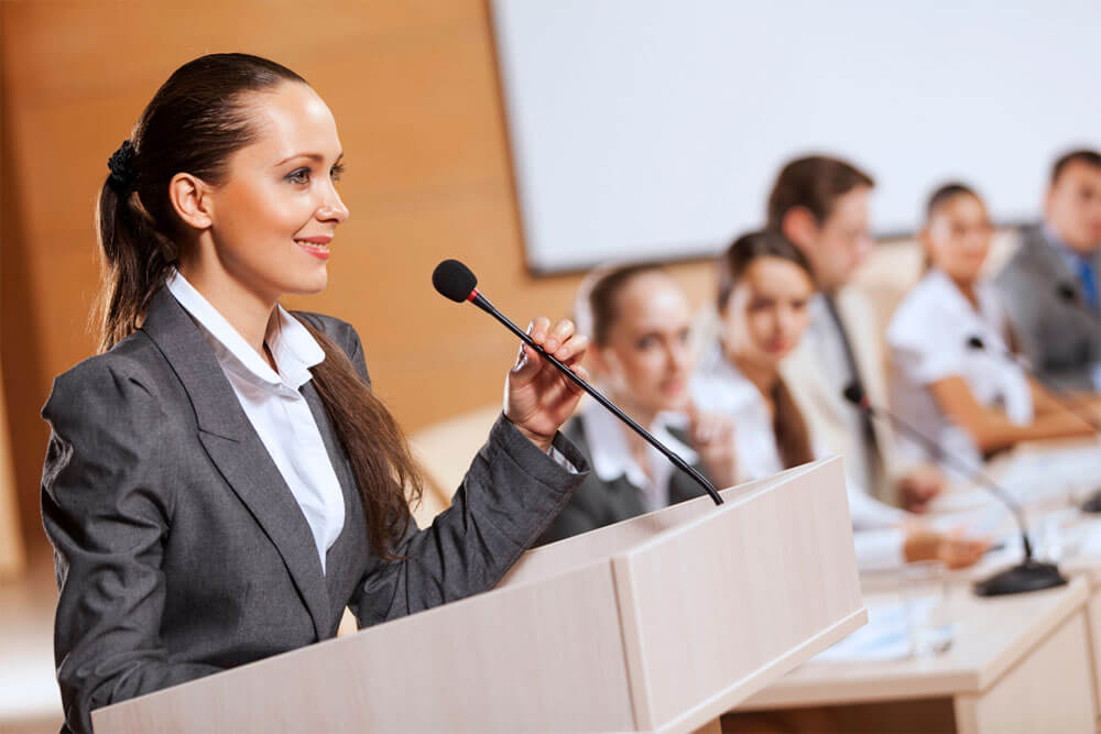 Business person using her Presentation Skills Training at a conference in Derby