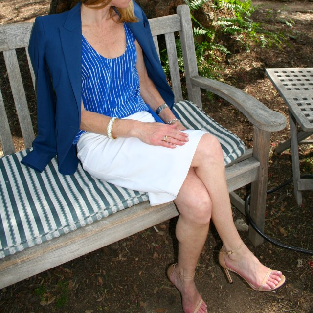 blue top and white skirt