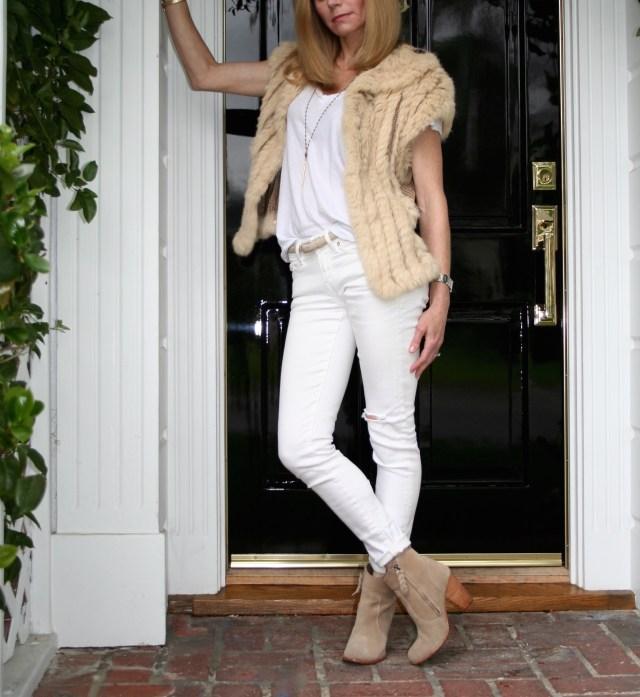 fur vest and jeans