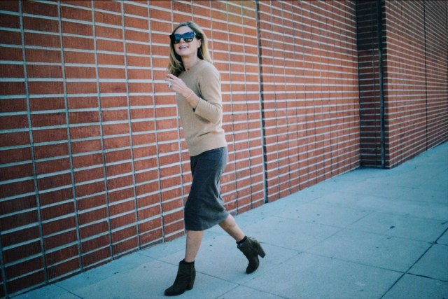 layering cashmere sweaters over dresses