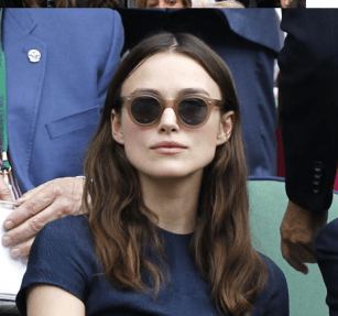 Keira Knightley wearing round sunglasses