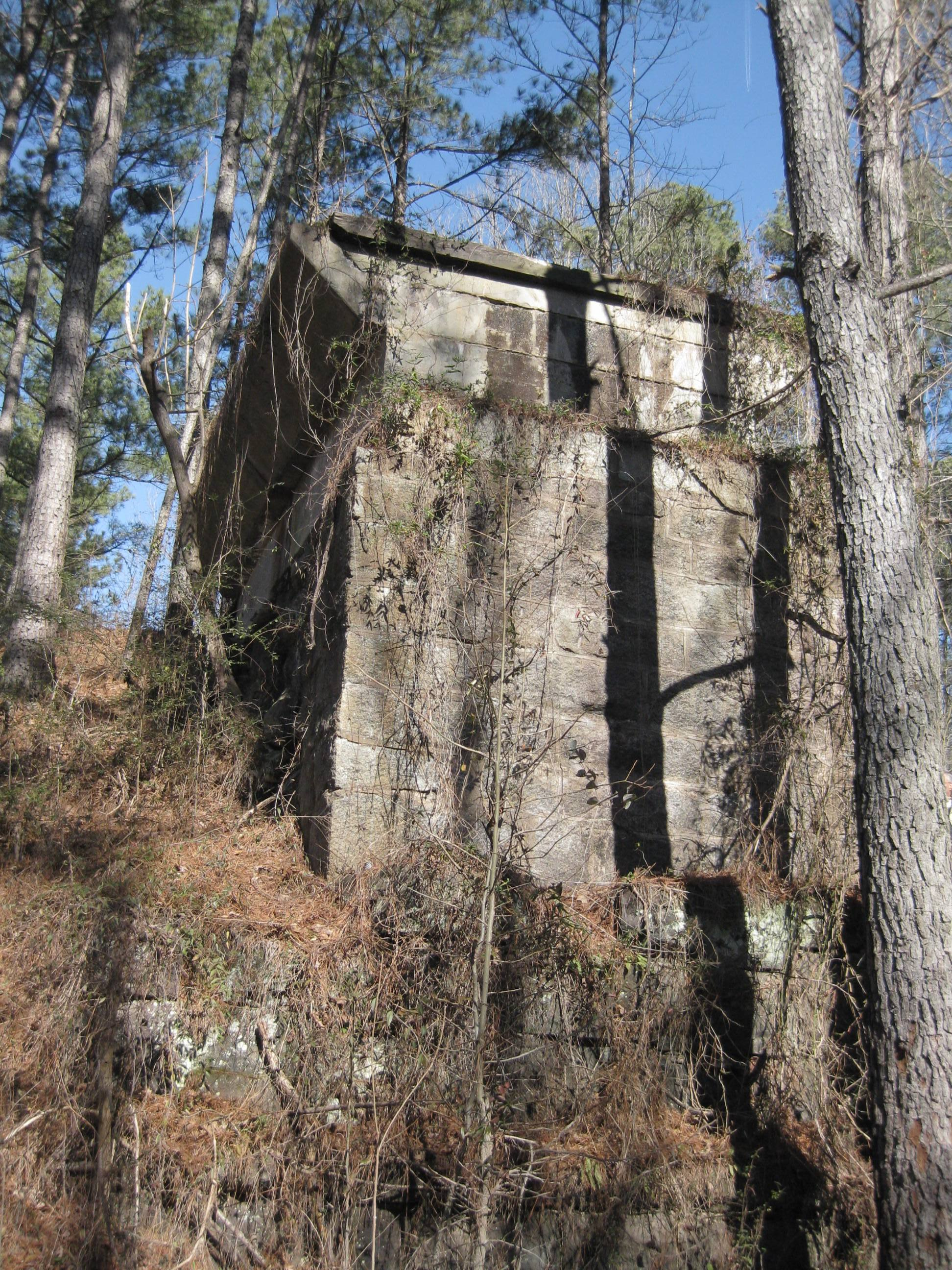 Railroad bridge abutment from the ground.