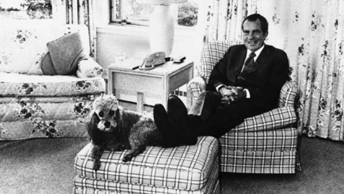 President Richard Nixon is shown in the White House with his dog, Vicky, the night before he resigned in August 1974.