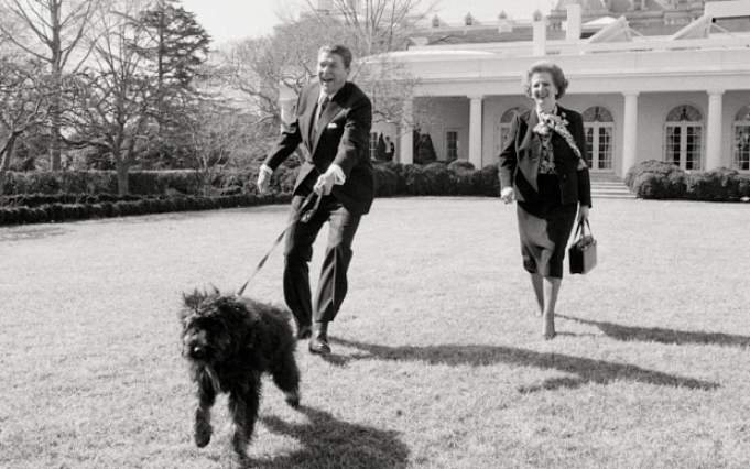 Margaret Thatcher and President Reagan walk Lucky, Feb. 20, 1985.