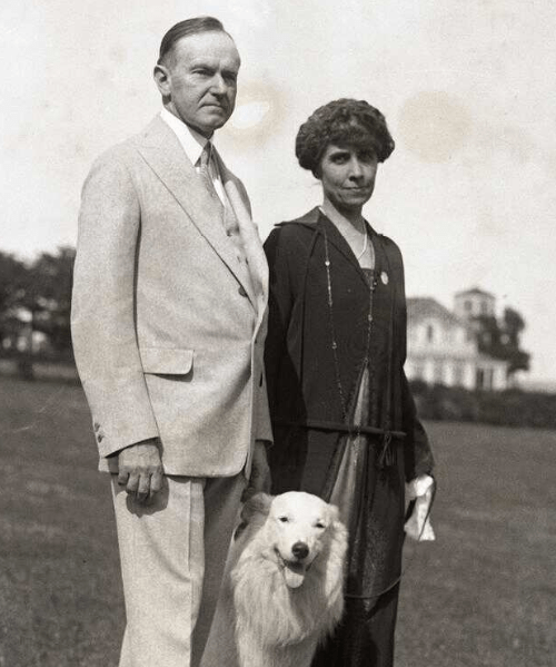 President Coolidge, his wife, Grace, and one of their white collies, Rob Roy, circa 1925.