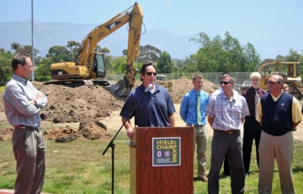 Dave Odell, second to right front row, is on the frontlines of many community athletics projects. UCSB men's soccer coach Tim Vom Steeg speaking here at the ground breaking ceremony for the new turf field at San Marcos High School.