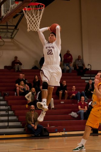 Dave Odell's Westmont athletic department finished 13th this year in the NAIA Director's Cup, the Warriors' best result since 2002. Here Jordan Sachs goes up for a break-away dunk for the Westmont men's basketball team.