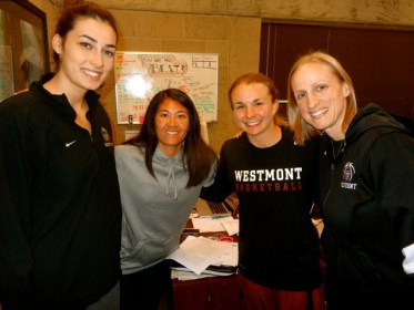 Canitez hanging with the Westmont coaching staff, Selena Ho, Emily Johnson, and Kirsten Moore, in the athletic offices. (Randy Weiss Photo)