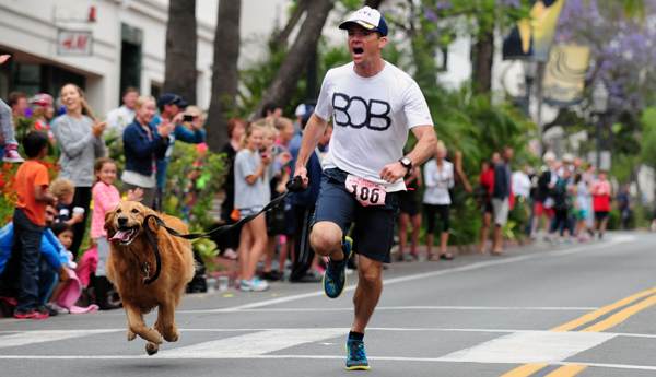 Steve Harding and his golden lab Bob won the dog mile in 4:26.