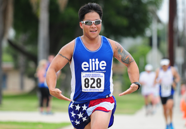 Gabe Wu approaches the finish line in holiday appropriate attire. (Presidio Sports Photos)