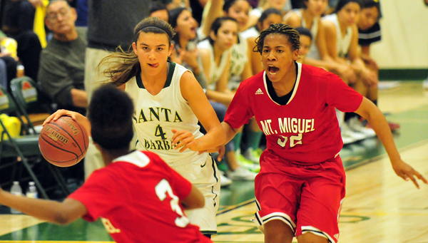 Amber Melgoza of Santa Barbara dribbles up court  while being pressured by Mount Miguel players.